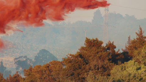 Fire fighter plane drops fire retardant on a forest fire 7 Live Action