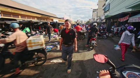 Close Scooters Move along Sidewalk Market on Asphalt in Vietnam Footage
