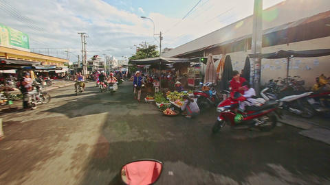 Scooters Move along Sidewalk Market on Asphalt in Vietnam Footage