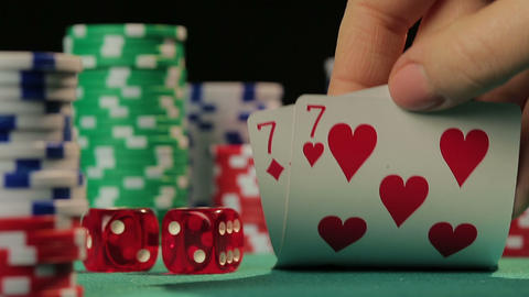 Risky poker player catches pocket pair, gambler hopes to win fortune in casino Live Action