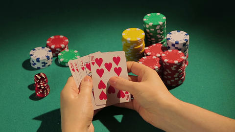 Successful poker player catches royal flush, using strategy to win more chips Footage