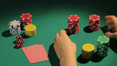 Experienced poker player goes all-in, betting all chips, gambler bluffing to win Footage