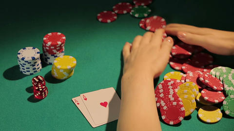 Successful player happy to win bank in poker game, taking all chips off table Footage