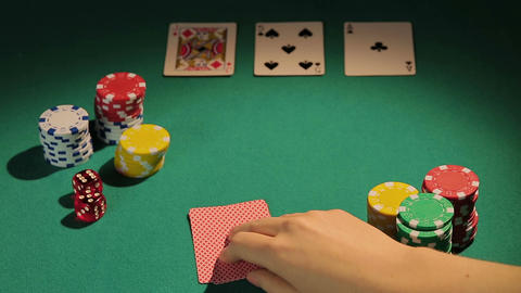 Poker professional checking cards, betting chips to raise bank, game strategy Footage