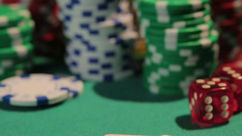 Close-up shot of two aces on poker table, defocused chips on background, casino Footage