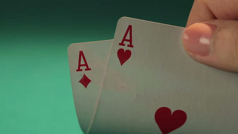 Close up shot of dice and gambler's hand holding pair of aces, game addiction Footage