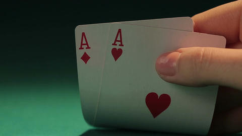 Cautious poker player looking at cards, having doubts about bet, risky decision Live Action