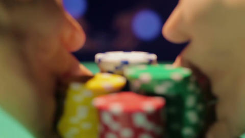 Dealer's hands taking pile of poker chips off the table, atmosphere in casino Footage