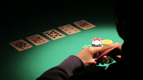 Shadow of experienced gambler betting poker chips, waiting for rival's action Footage