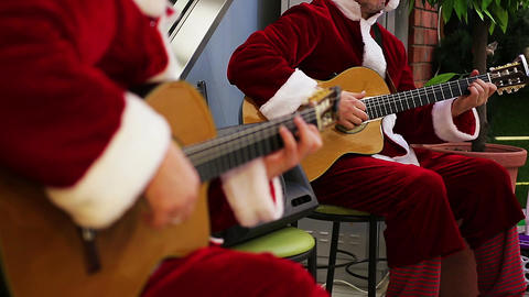 Musicians performing Christmas carol songs to cheer up people before holidays Footage