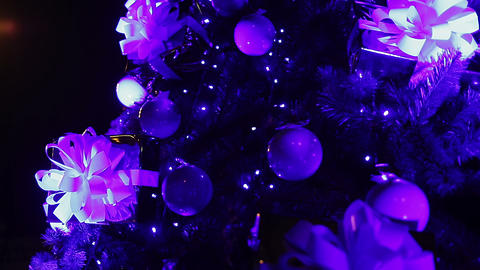 Nice decorations and garland lights sparkling on Christmas tree, magic night Footage