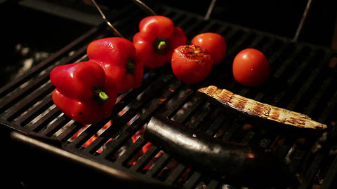 Restaurant chief cooking appetizing juicy vegetables on grill for tasty dinner Footage