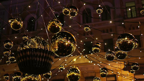 Shiny golden decorations hanging outdoors, sparkling to create festive mood Footage