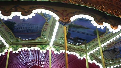 Time-lapse shot of colorful and brightly illuminated merry-go-round rotating Footage