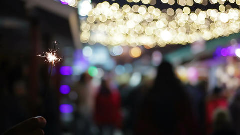 Defocused silhouettes of people enjoying winter street festival to mark New Year Footage