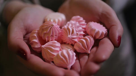 Woman holding handful of nice tasty sweets, delicious dessert at confectionery Footage