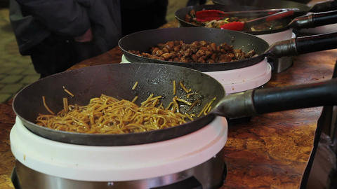Appetizing grilled food in the big pans. Cool open-air food festival. Market Footage