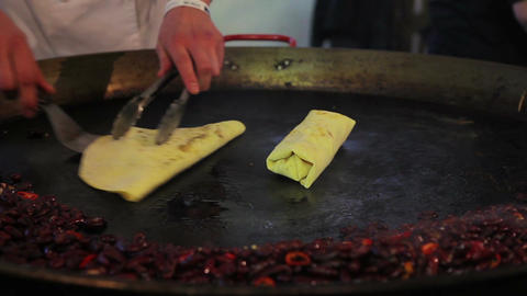 Eastern cuisine. Male cook preparing tasty but unhealthy meal, street food Live Action