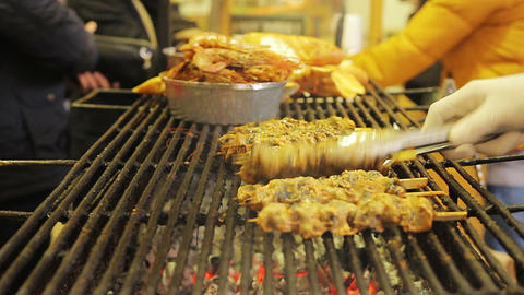 Gastronomy, street food fest. Appetizing grilled meat. Cooker preparing a meal Footage