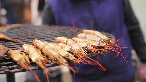 Many kinds of seafood at the street food-fest. Saleswoman. Mediterranean cuisine Footage