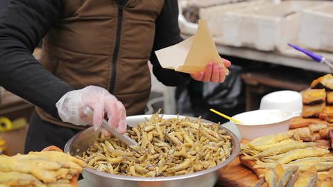 Street food, fried anchovies and other seafood. Crispy salty snacks, beer party Footage