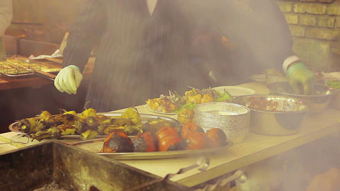 Gallant cook dressed in a suit cooking outdoors. Unordinary street food seller Live Action