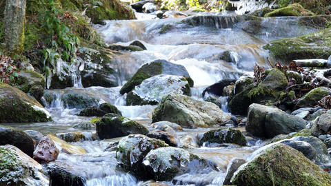 Stream flowing over mountain rocks Footage