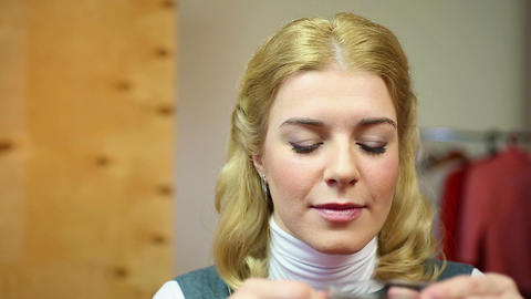 Girl hearing good news. Satisfied pretty blond woman drinking tea at home Footage