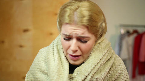 Sneezing blond woman at home. Medicine and healthcare, allergies and cold Live Action