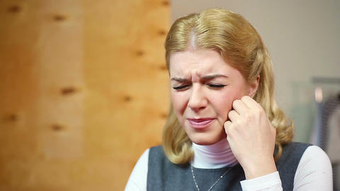 Blond lady having toothache or headache, feeling depressed. Health problems Footage