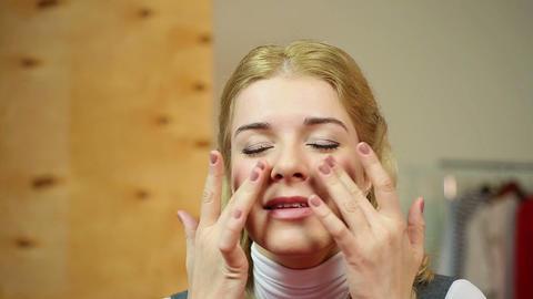 Female applying expensive anti-aging cream, enjoying the smoothing skin effect Footage