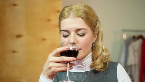 Woman sommelier tasting and evaluating red wine. Female drinking alcohol Footage