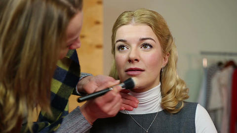 Professional artist applying makeup on set. Actress getting ready for filming Footage