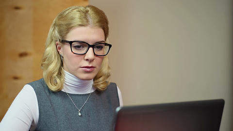 Industrious businesswoman reading e-mails, working on her laptop in office Footage