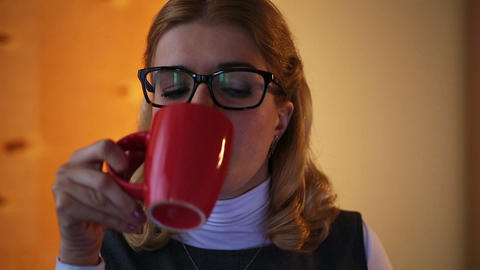 Tired businesswoman working late on computer and drinking coffee in office Footage