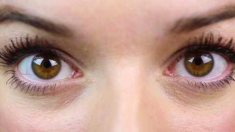Macro view of surprised female eyes, beautiful girl saw something frightening Footage