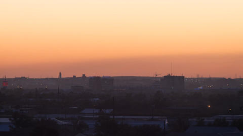 Sunset over the industrial city. Sun close-up. Karaganda, Kazakhstan. Zoom. Time Footage