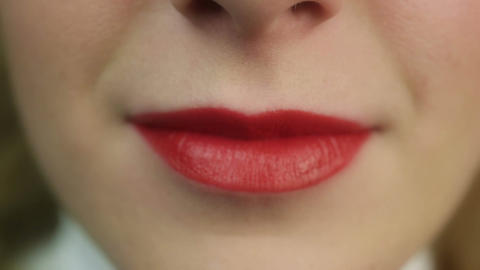 Sexy and sensual red lips. Woman blowing air-kiss. Perfect make-up, flirt Live Action
