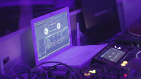 DJ working behind console. Nightclub audio equipment. Cool party. Relaxation Footage