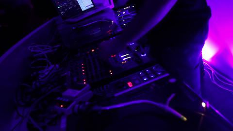 Dancing dj performing music in the night club. Cool party. Modern music Footage