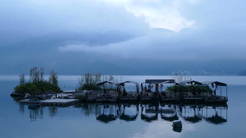 Floating boat island at the riverside of the Shui She Wharf at sunrise Footage