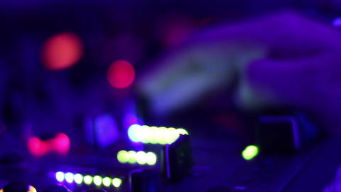 Glowing buttons on professional audio equipment in the night club. DJ, party Footage