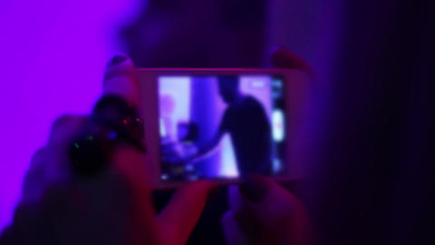 Glamorous girl photographing cool deejay standing at mixer and playing music Footage