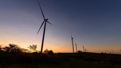 wind turbines park for make the electric power from wind in sunrise Live Action