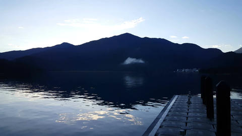 Clouds over the mountains at the riverside of the Shui She Wharf at sunrise Footage