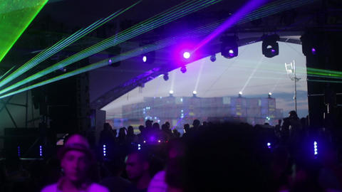 People in a disco at night. Party. Dance floor. Festival. Joy Live Action