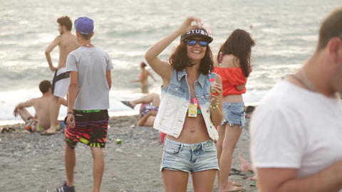 Girl blows soap bubbles at a disco. Festival. Joy Live Action