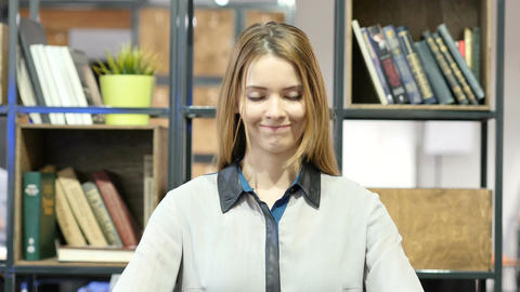 Agree, Woman Gesture of Yes, Shaking Head, Indoor Office Footage