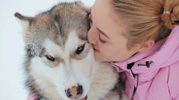 Young Woman Caresses the Dog GIF