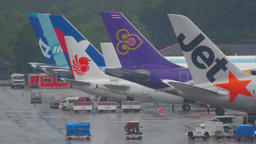 Tails of some airplanes at Phuket airport Live Action